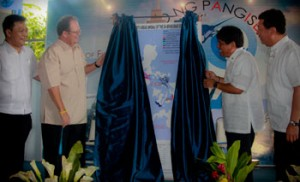 ECOFISH proponents unveil the project's site map during the launch. From left are Chief of Party Geronimo Silvestre and Chief of Department of Energy and Environment Office Rolf Anderson of the USAID; Department of Agriculture Secretary Proceso Alcala and BFAR Director Asis Perez