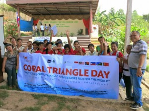 Teachers and students of Canique National High School and the local government officials of Barangay Canique in Taytay, Palawan.