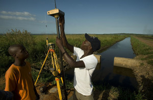 A surveyor takes GPS coordinates on a water-control canal for the Baixo Limpopo Irrigation and Climate Resilience Project near Xai Xais Mozambique. (Photo from: CIF Voices)