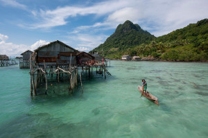 Bajau Laut sea gypsy houses on stilts, Pulau Gaya, Malaysia. (Photo by: © Jürgen Freund / WWF-Canon)