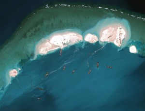 A satellite image from 16 March shows work on an emerging artificial island at Mischief Reef in the South China Sea. (Photo by: Center for Strategic and International Studies, via Digital Globe)