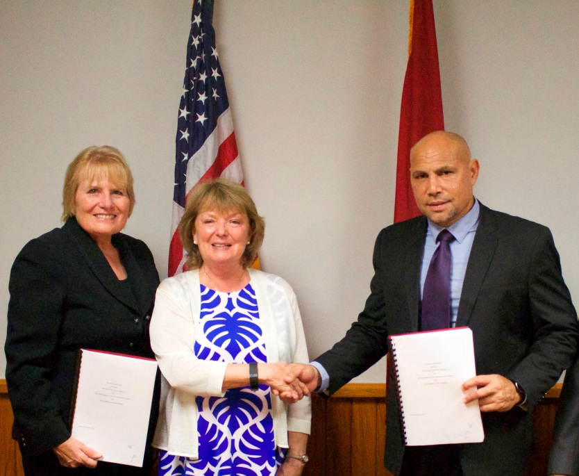 Photo: U.S. Ambassador Catherine Ebert-Gray, USAID Mission Director for the Philippines, Pacific Islands, and Mongolia, Dr. Susan Brems and Minister for National Planning, Charles Abel after the signing of the bilateral assistance agreement.