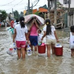 Family left homeless by Tropical Storm Ketsana (Ondoy) in Manila, Philippines.